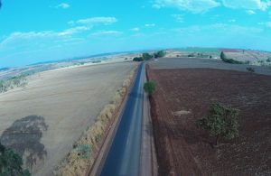 Serviços de asfaltamento da estrada que liga Lagoa Formosa a Monjolinho de Minas